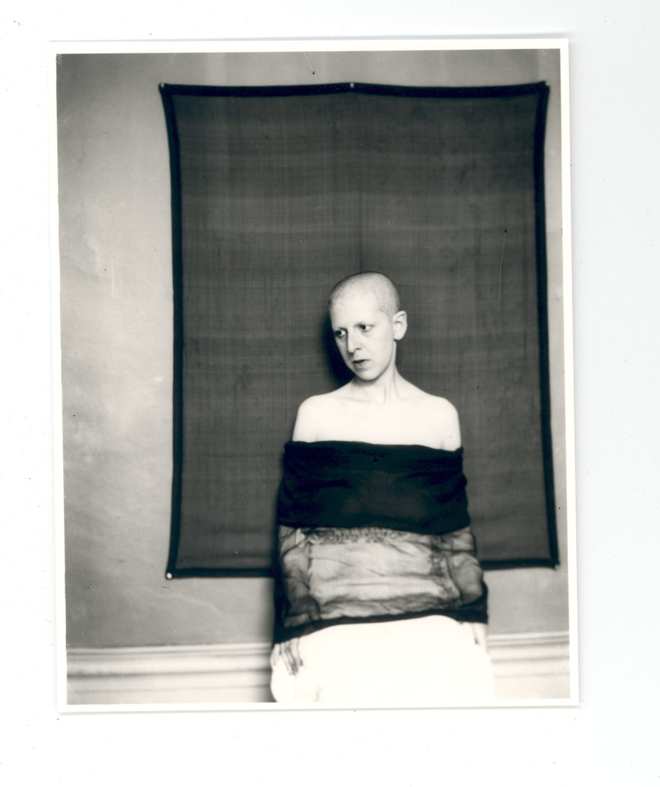 Self-portrait (shaved head, material draped across body) by Claude Cahun, 1920. Jersey Heritage Collections © Jersey Heritage