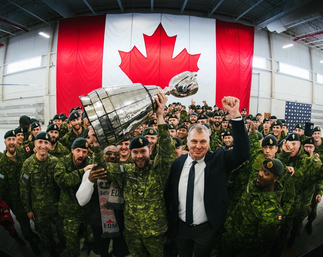"The Grey Cup with members of the Canadian Forces, Henry ""Gizmo"" Williams and Commissioner Randy Ambrosie. Photo credit: Johany Jutras/CFL.ca"