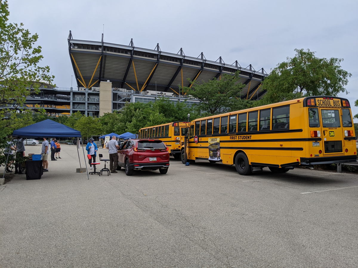 The event was held at Stage AE. Volunteers collected monetary donations and repurposed computers and tablets, which will be donated to local students for the upcoming school year.