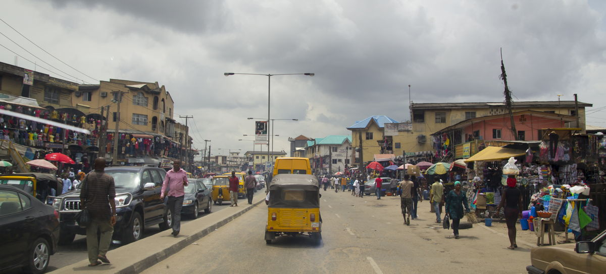 People in the street in the city view of Lagos, the largest city in Nigeria and the African continent. Lagos is one of the fastest growing cities in the world.