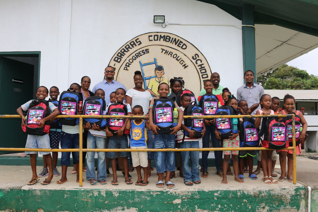 Group photo of students and teachers at the Des Barras Combined School with donated gifts.