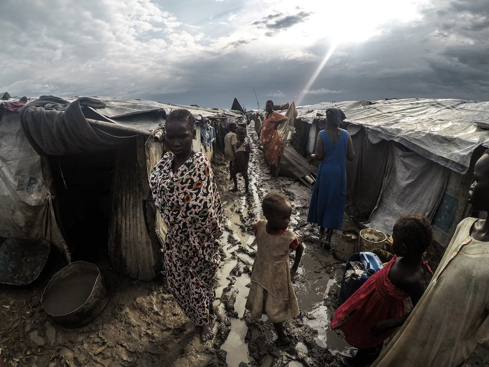 During the rainy season , which can last between June and November, the camp becomes badly flooded. The paths turn to liquid mud. Living conditions are difficult as the packed earth floor in the shelter will become puddles. Photographer: Raul Fernandez Sanchez/MSF
