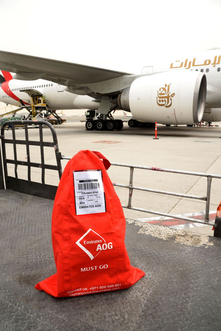 Emirates SkyCargo has designed a striking 'Must Go' bag to alert staff to the urgent nature of shipments