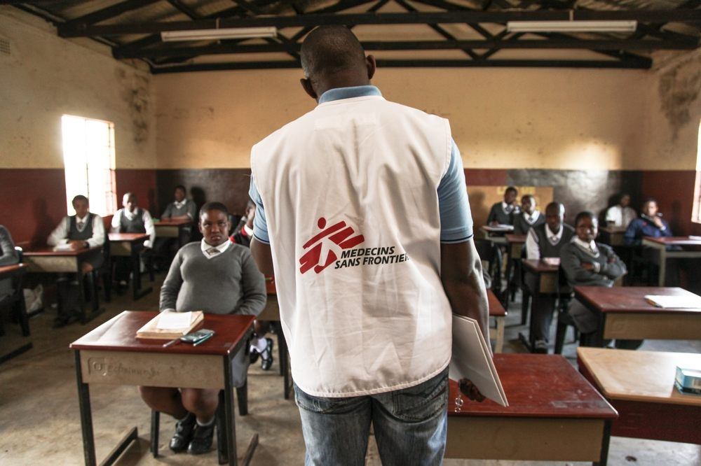 Learners of Hhashi High School in the remote Umlalazi Municipality under Uthungulu Districtict in KwaZulu-Natal stand in line to receive HIV Counselling and Testing at Medecins Sans Frontieres (MSF) Mobile 1-Stop Shop. MSF uses the vehicle to deliver HIV Counselling and Testing to people of all ages in rural KwaZulu-Natal, the South African province with the highest prevalence of HIV infection. Photographer: Greg Lomas / Médecins Sans Frontières