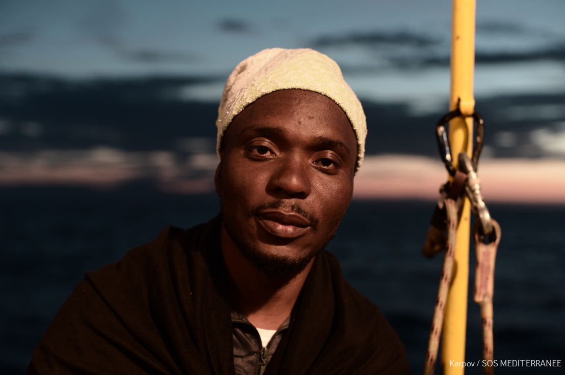 Moses <br/><br/>I&#039;ve been in Libya since 2016. Lliving there is from hell to hell. I&#039;ve been from prison, to prison to prison. I have not yet cried my tears of joy. I went from Sierra Leone to Agadez to Sabha, it took me two weeks in the desert. That desert is not an easy journey. To pass through that place you see people asking you to drink your urine, as there&#039;s no water. It&#039;s all they have. I saw people begging and dying in-front of me, everyday along the desert. You really must have strength to survive, if you don&#039;t have strength, you die. I saw many men fall down, we don&#039;t wait for them, we keep walking. On the way, we got in a van, I thank God, our driver was so intelligent. They run after us and we run into some place and hop in the van, he just tell everyone is lie down and he guarded us, while they were shooting, bam, bam, hitting the van. It were Libyans I am sure! They just catch people and put them in a place, ask for money, beat you, torture you. On our way coming, they sold us in Bani Walid. Bani Walid was hell. I see deaths. I cry for death. But death did not come. My first time in Bani Walid, I saw them shoot someone right in front of me, in prison. They asked to pay, and they give us time, but the Arab man, he just come and took some boys who were there a long time, just in front of me, pop, pop, pop. If you stay too long in the prison, they clean. By clean, it&#039;s not by washing, it&#039;s by shooting, older people and sending them to the desert, they just throw them away. One day, they shot my friend in front of my face, as he was taking too long to piss. The bullet hit him in the leg. They targeted to kill him. When they fall, they men ask us to carry the bodies to the desert. During one of these times, I noticed one of these boys was not dead, so we agreed not to say anything. I had some dinars on me and put it in his pocket and told him to make his way out. The next he couldn&#039;t make it, he died, because of 