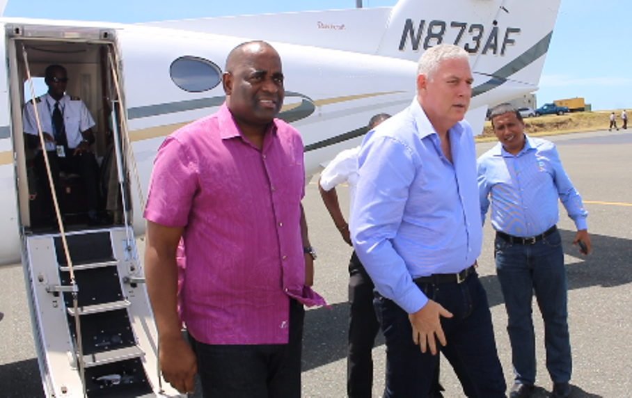 Prime Minister Skerrit and Prime Minister Chastanet disembark aircraft in the British Virgin Islands.