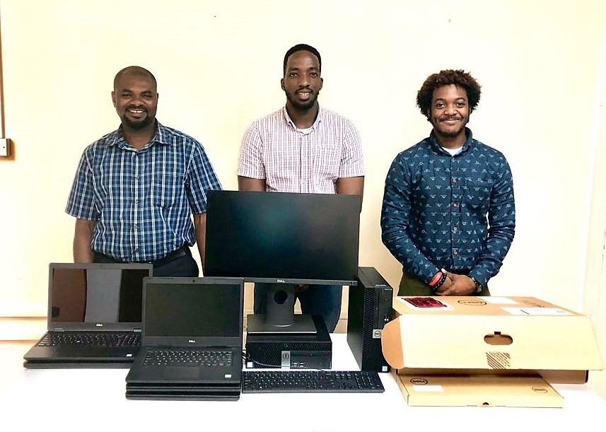 Some staff members of the CSO Grenada with donated equipment.