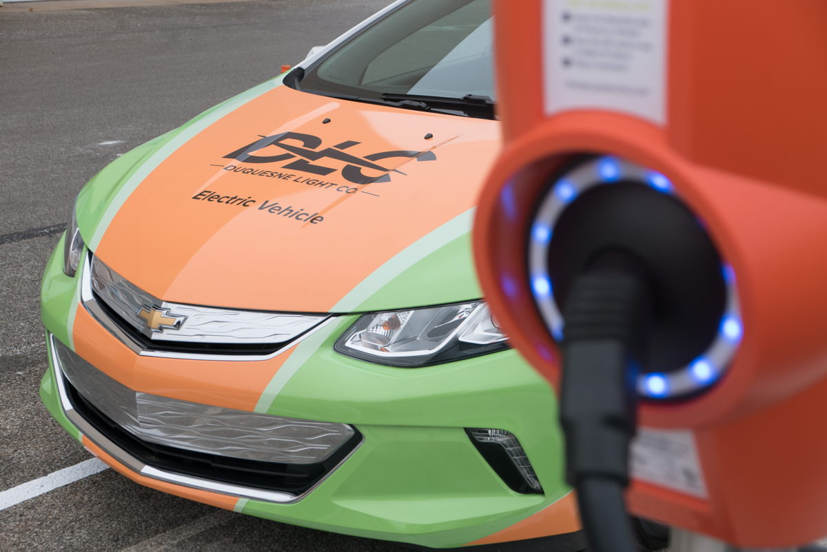 Duquesne Light Co. is empowering all of its customers to experience the benefits of electric mobility. Photo: An electric powered Chevy Volt parked at a charging station outside of a DLC facility is part of the utility
