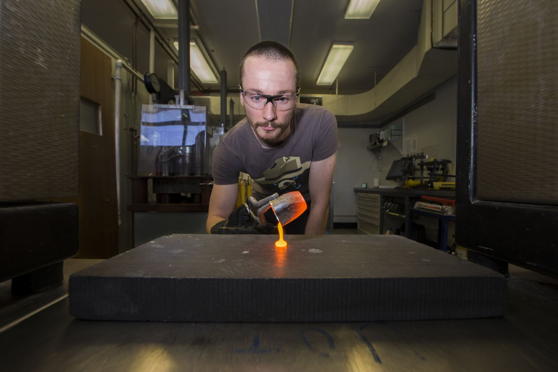 The silicate melt is poured on a graphite plate to make glass. Image credit: Stuart Hay, ANU