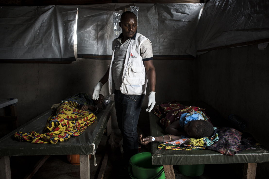 An MSF nurse checks on cholera patients in an MSF-supported cholera centre on the shores of Lake Albert on 5 March 2018. The town of Tchomia is the one of the main towns for thousands of Congolese IDPs to flee to refugee camps on the shores of Lake Albert in Uganda. After the cholera outbreak in the refugee camps in Uganda, there is a fear of a subsequent outbreak in Tchomia, which would affect thousands of IDPs taking refuge along the shoreline of Lake Albert in DRC. PHOTO/JOHN WESSELS