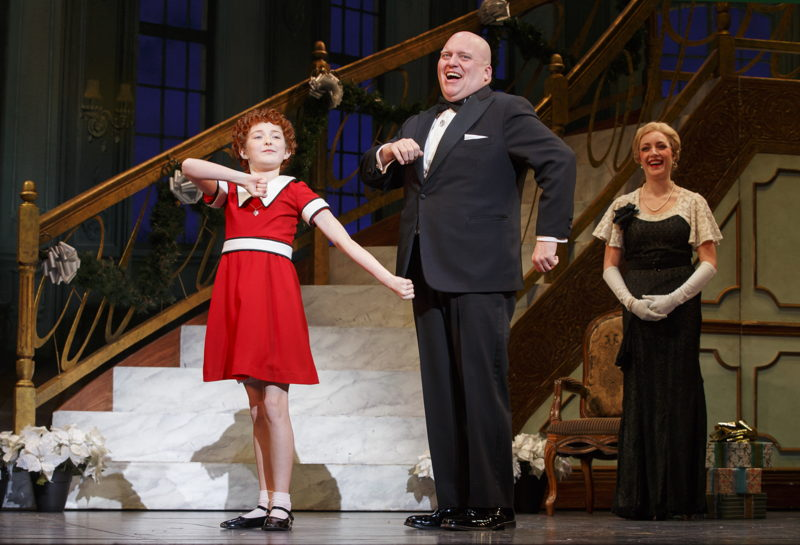 """Heidi Gray as Annie, Gilgamesh Taggett as Oliver Warbucks and Chloe Tiso as<br/>Grace Farrell in """"I Don't Need Anything but You""""<br/>Photo: Joan Marcus"""