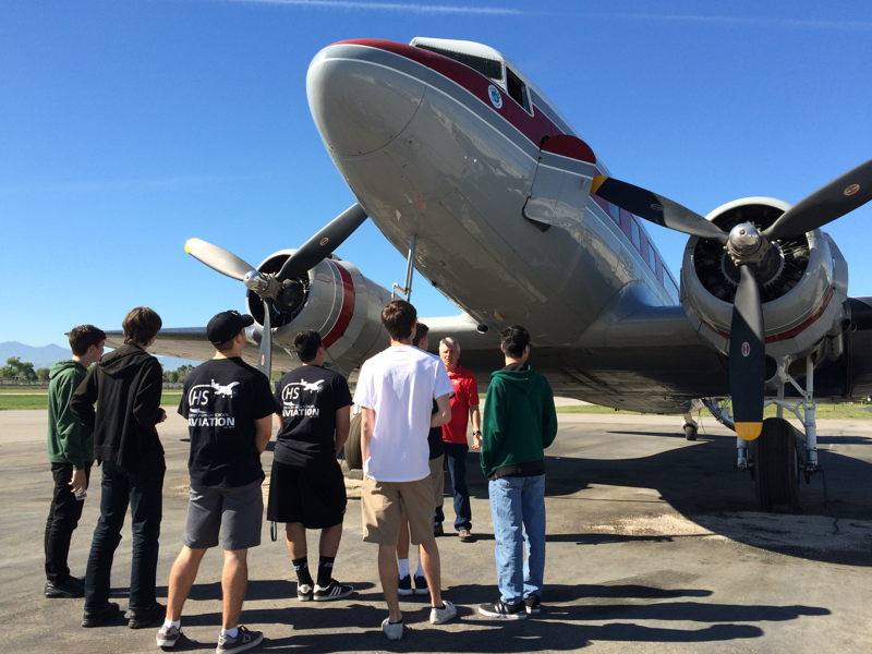 Aviation II students at Canyon High School toured Flabob airport and sat inside this DC-3 while learning the history of the airplane. Then they took turns sitting in the cockpit.