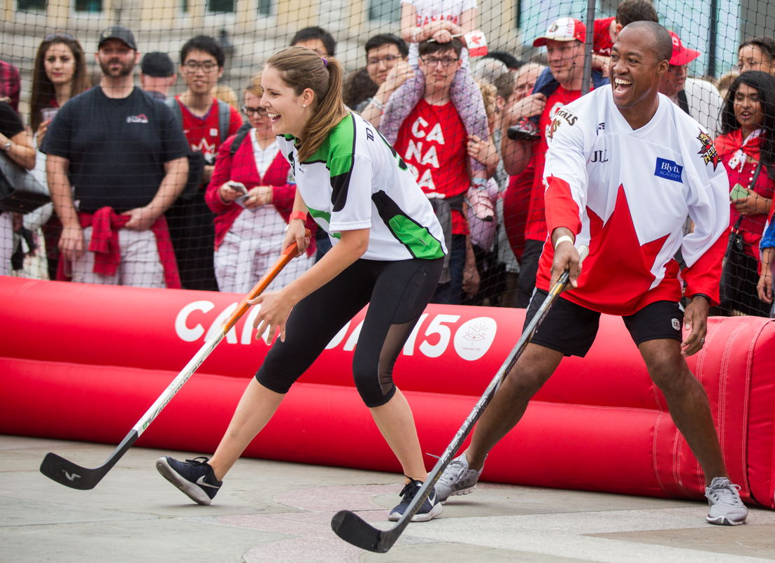 Henry Burris playing in the celebrity ball hockey game. Photo Credit: Jim Ross/CFL