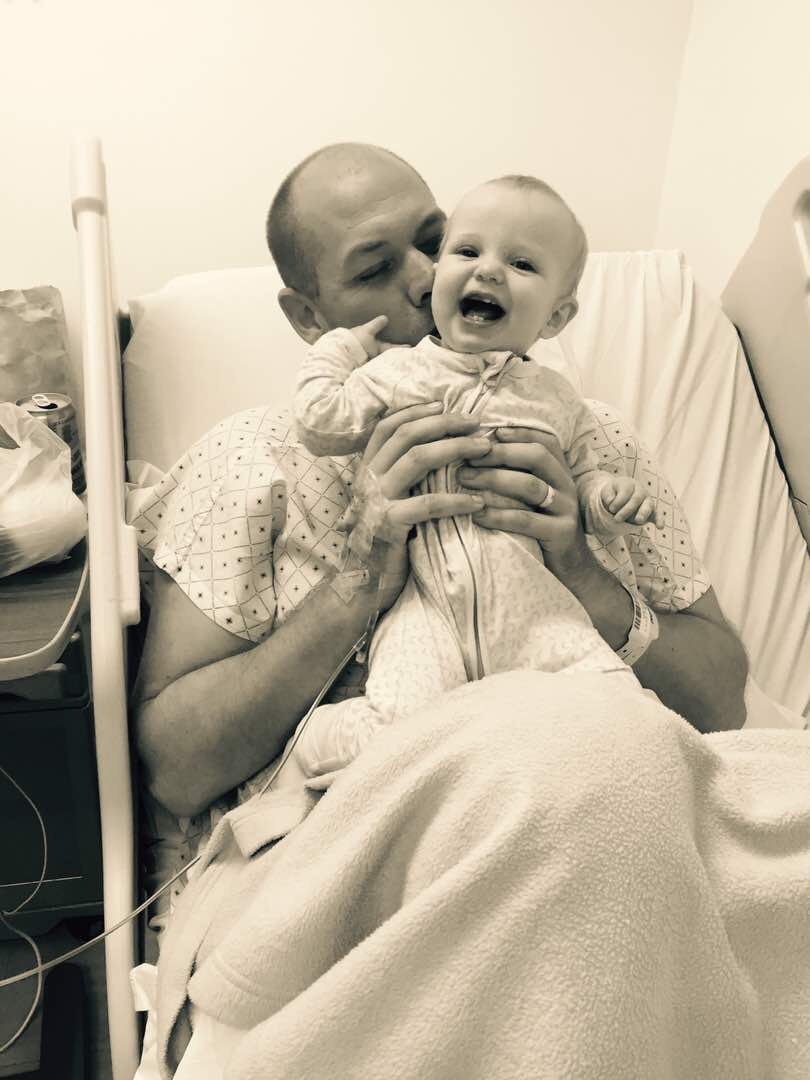 Back with family - Adam Harvey after the bullet was successfully removed