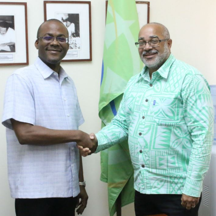 Mr. Bevil wooding and OECS Commission Director General Dr. Didacus Jules