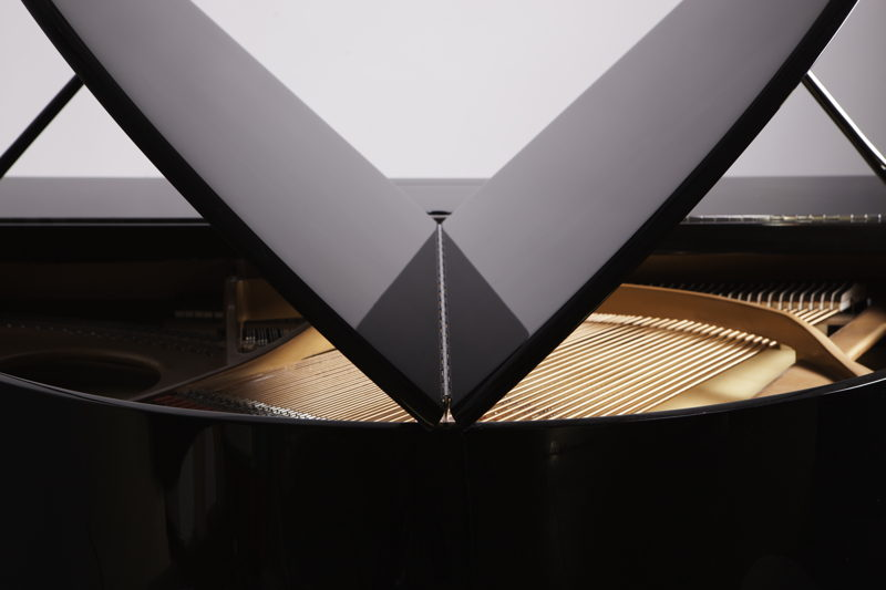 An Edelweiss self-playing piano in close up.