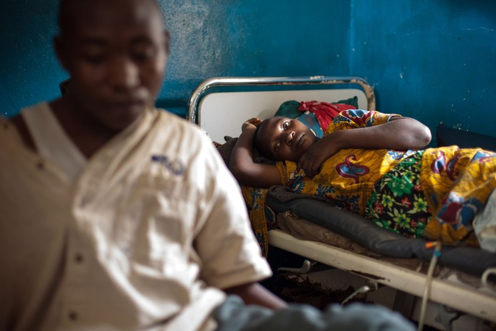A woman is lying on her bed recovering from a caesarian section at Mweso General Hospital on the border between the Masisi and Rutshuru territories in the North Kivu province of the Democratic Republic of the Congo, February 7, 2017. Photographer: Gwenn Dubourthoumieu