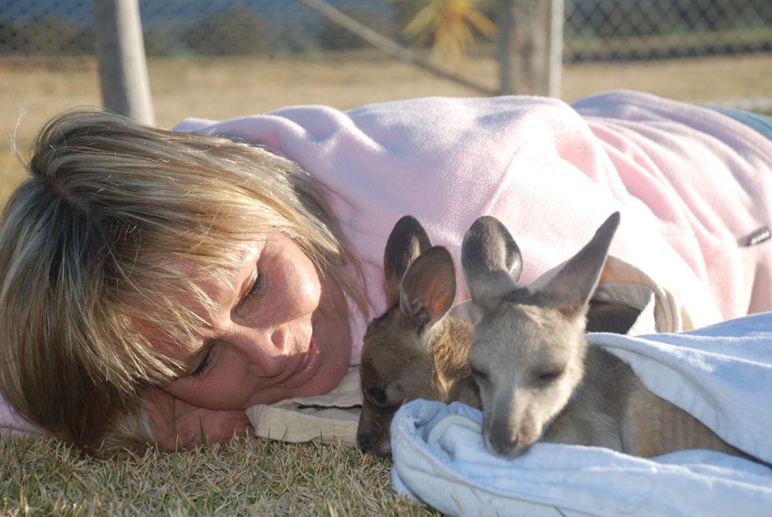 Australian Story Belinda Green with a couple of joeys.
