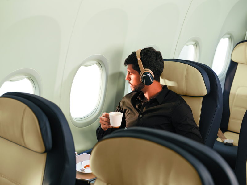 Business Class passenger wearing headset