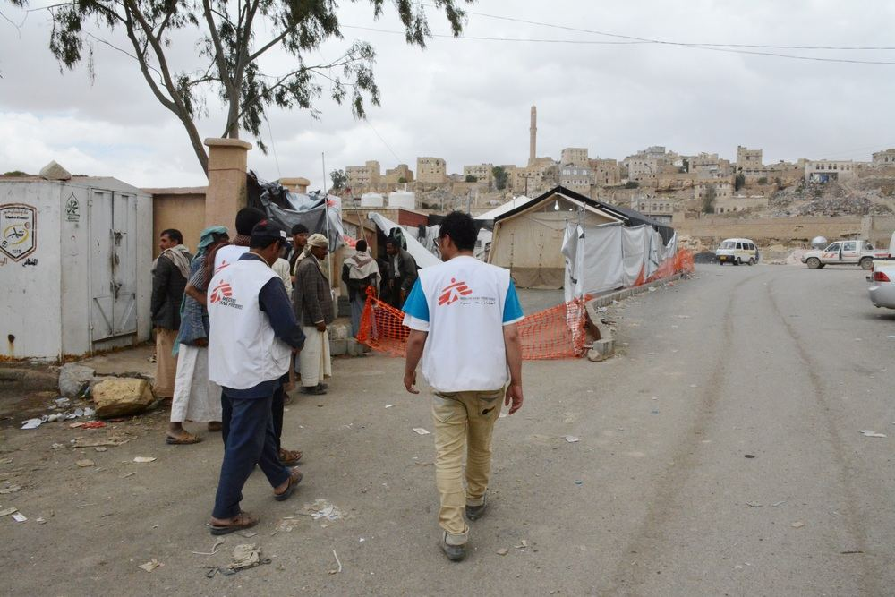 MSF logistic team in front of MSF cholera treatment center in Khamer. The team has set up four tents for the center to be able to deal with the increased number of patients with cholera in Yemen. MSF is receiving an increased number of cholera patients in Yemen since the beginning of May 2017. This cholera treatment center alone, treated more than 1200 patients in less than two weeks. The center is still receiving an increased number of patients. Photographer: Malak Shaher/MSF