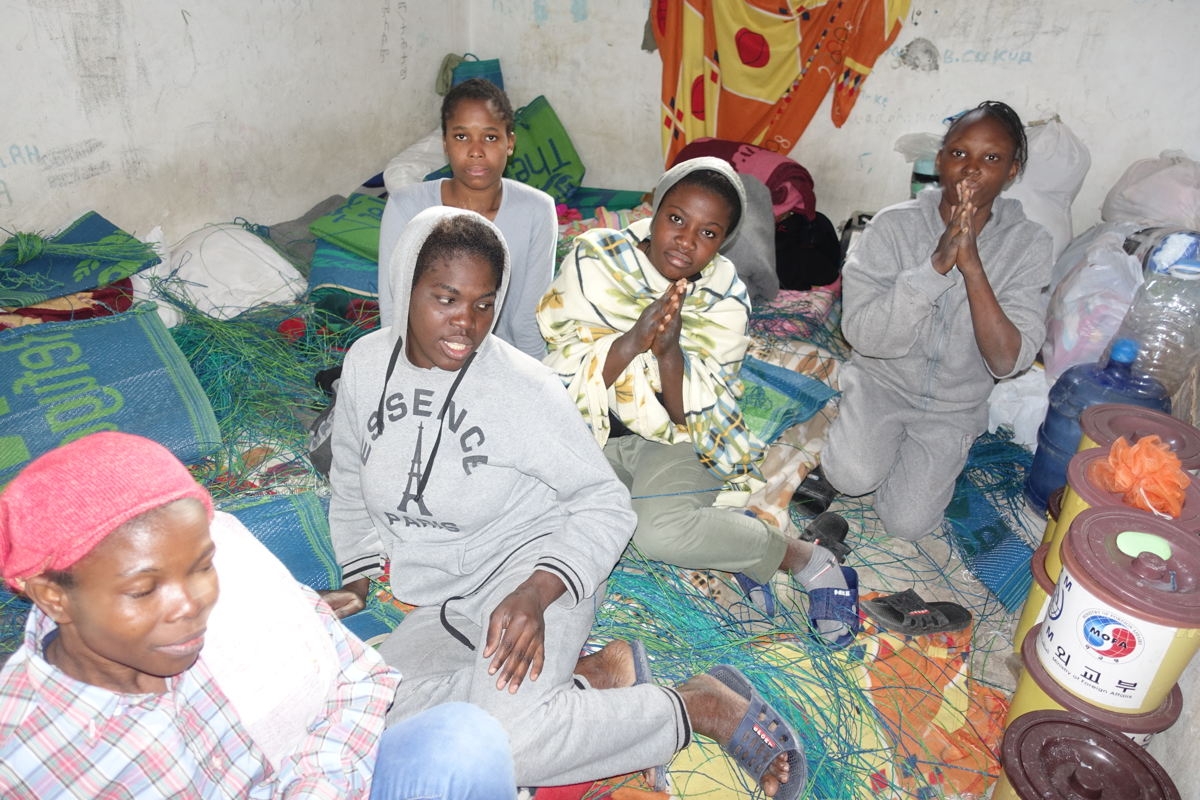 Some of the about 40 inmates present in the detention center at the time of visit. They reported being from Nigeria and held here since 1 month without any contact to with the outside world or their families back home. Very depressed women and desperately asking for help. 