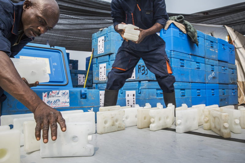 Medecins Sans Frontieres (MSF) staff stock 17.000 icepacks in cooler containers. <br/><br/>The icepacks are cooled at a temperature of minus 22. Before being stored in blue boxes with the vaccines. They are spread out in the sun till they reach a temperature of 0°C. As the vaccines have to be kept at the temperature between +2 and +8°C. Photographer: Dieter Telemans