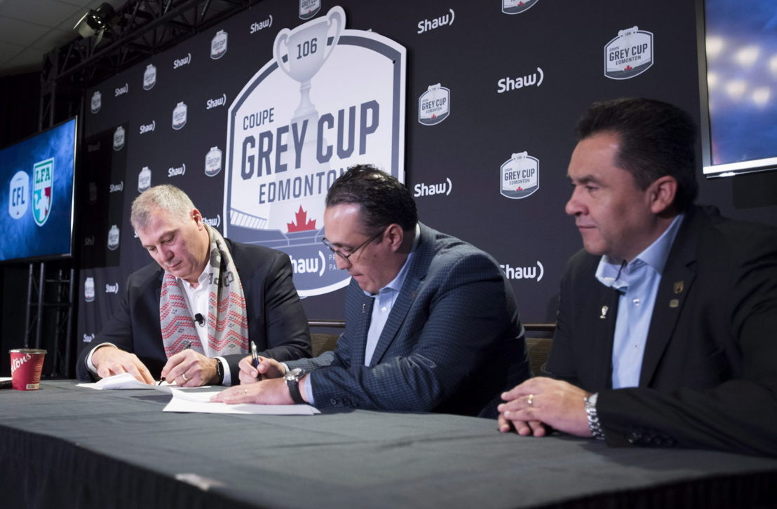 Commissioner Randy Ambrosie and Oscar Perez of the LFA signing a letter of intent. Photo credit: THE CANADIAN PRESS/Jonathan Hayward