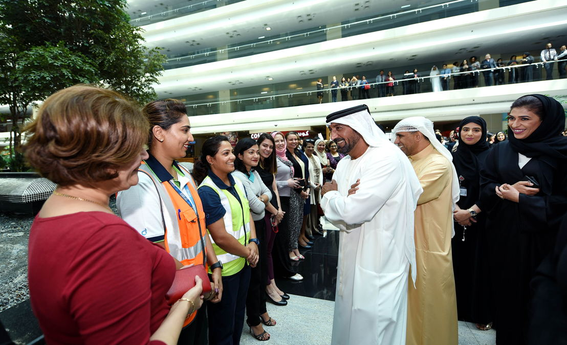 HH Sheikh Ahmed bin Saeed Al Maktoum, Chairman and Chief Executive, Emirates Airline and Group, interacting with female staff at the Group's headquarters on International Women's Day.