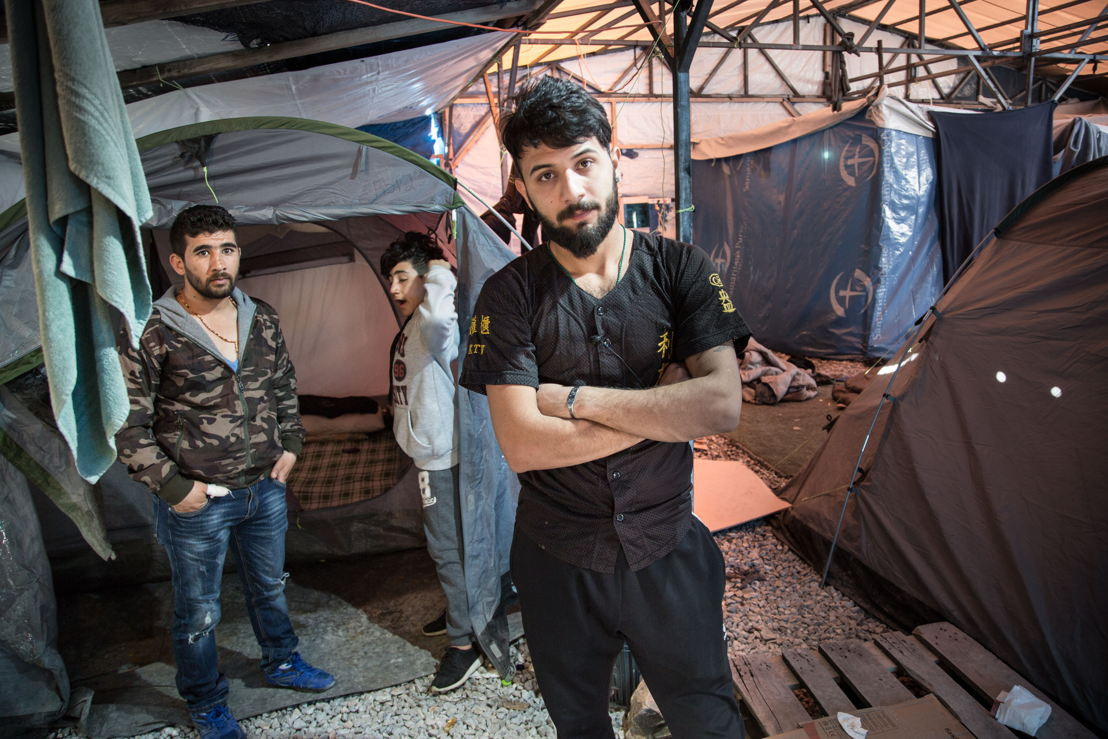 """Portrait of Sarmad, 23, from Iraq<br/><br/><br/>Sarmad left his country because of the security situation. He lived in Turkey for a short time but decided to try and reach Europe.<br/><br/>He has lived inside Moria camp for the past eight months and he works as a barber to collect some money to live.<br/><br/>""""… I am not talking only about myself, I am talking about all the refugees. Their life is difficult here, you can see, we live in tents. There have been problems here, some people died because of fire…we have had enough of war and of destruction, of explosions and killings every day, and of the houses collapsing on our heads. And we have come straight into psychological warfare.<br/><br/>Maybe we should come back to our country, then? That&#039;s it, maybe if we are going to die, we should die in our country."""""""