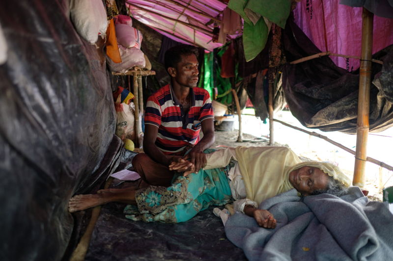 A Rohingya family is seen in their tent. Photographer: Antonio Faccilongo