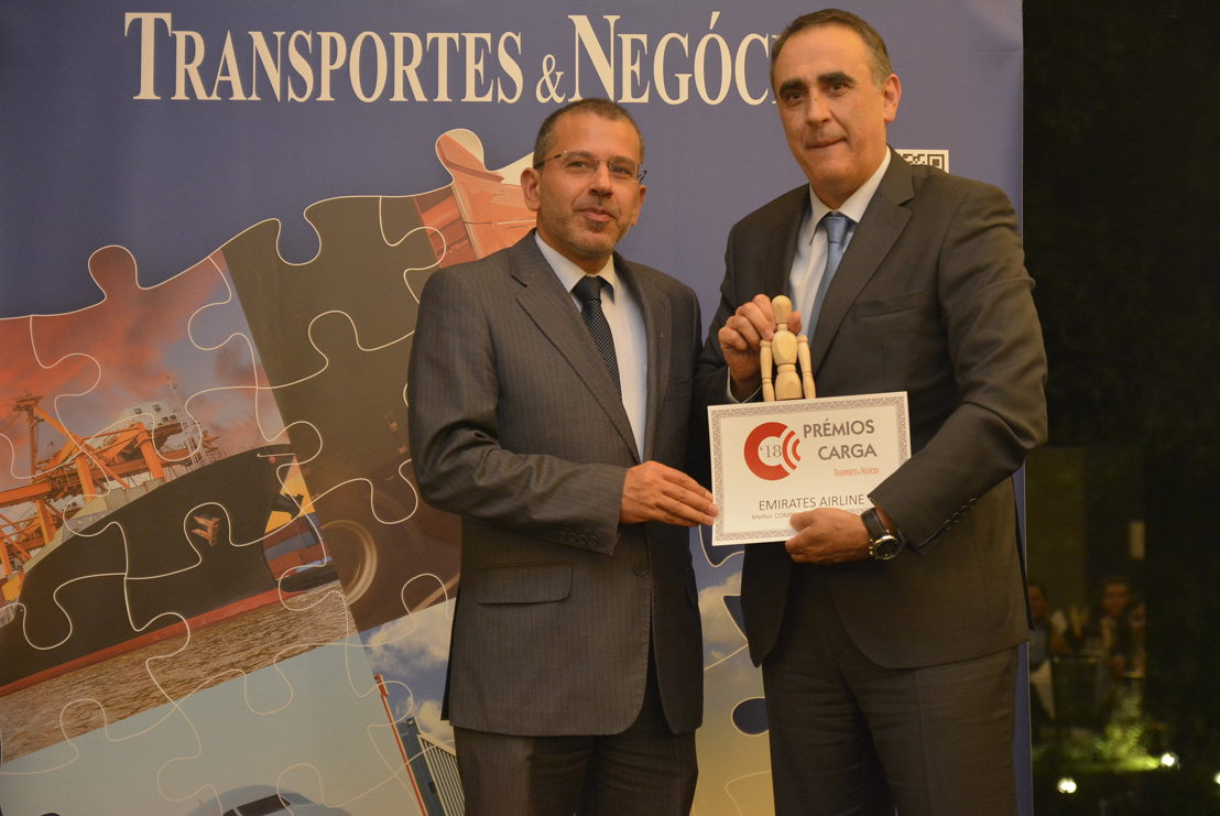 Fernando Gomes, Emirates Cargo Manager, Portugal (right) receives the award for Best Cargo Airline- Middle East, Asia, Pacific 2018 hosted by Transportes e Negocios