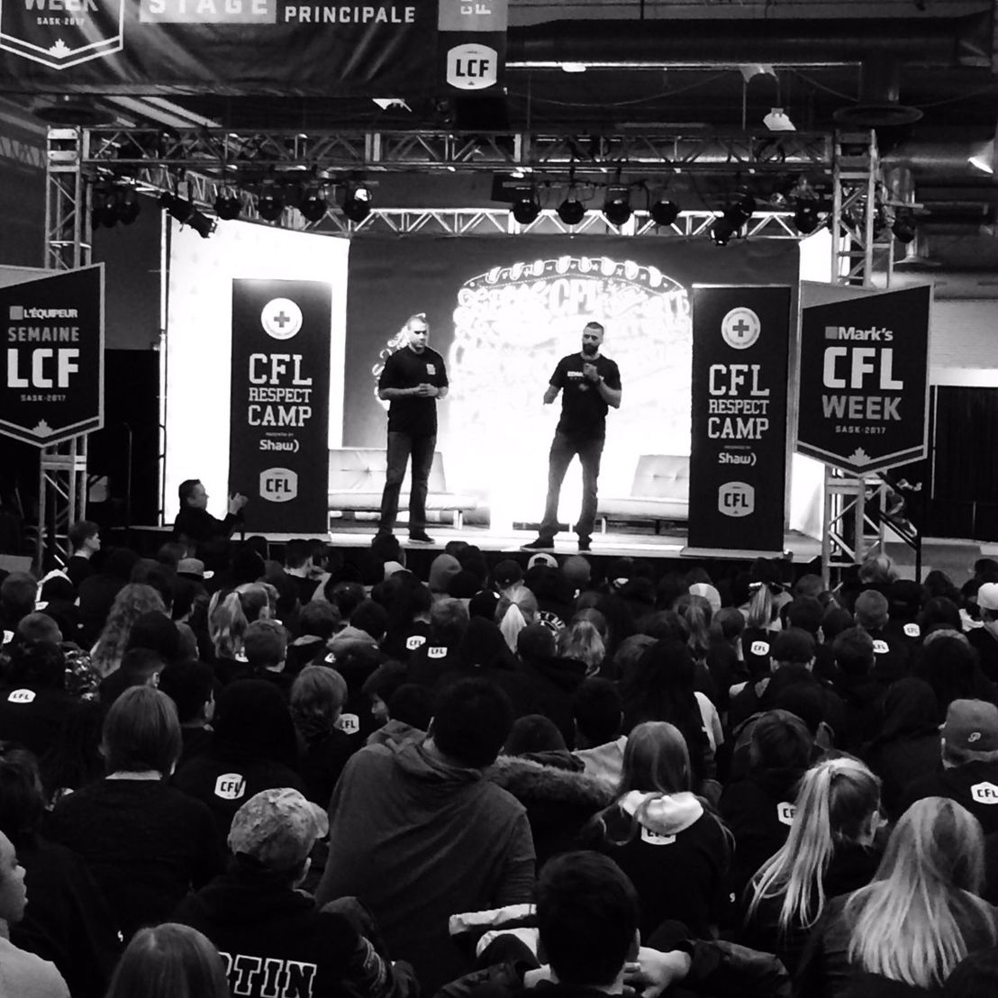 Spencer Moore & Mike Reilly onstage at the CFL Respect Camp with Red Cross presented by Shaw. Photo credit: Red Cross Saskatchewan