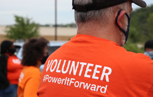 Here to Help: Employee Volunteers Serve Over 500 Families in One Day; Raise More Than $60,000 for Food Bank