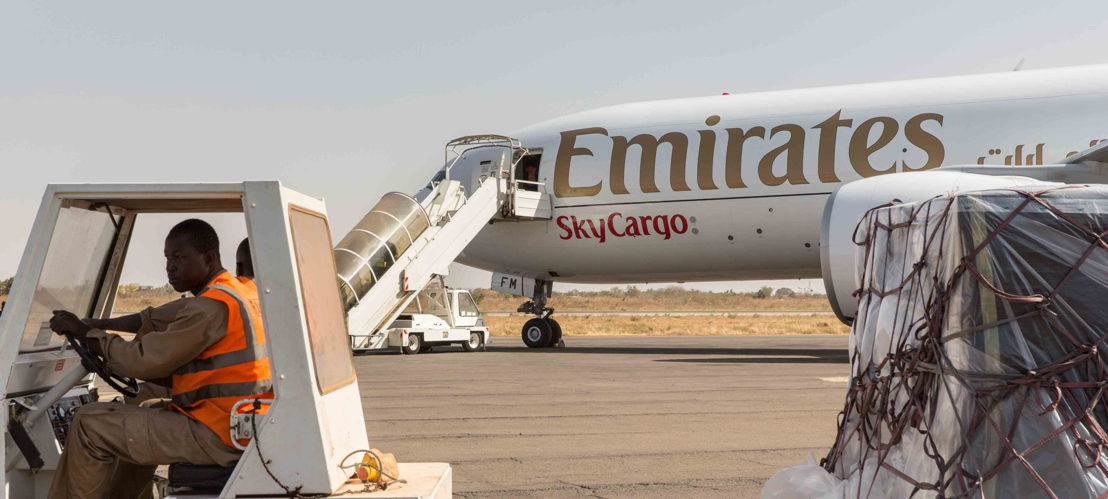 Cargo being offloaded from Emirates' Boeing 777F at Ouagadougou Airport.