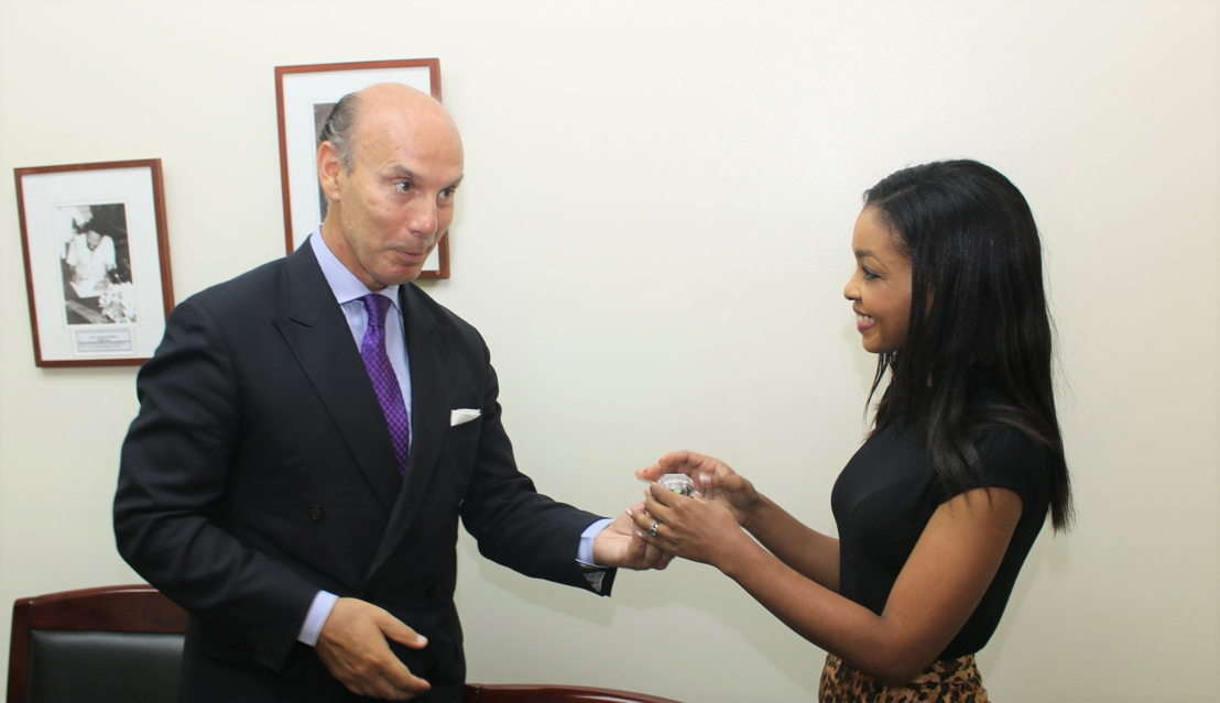 Communications Officer, Ms. Tahira Carter, presents Ambassador Carbajosa with a token.
