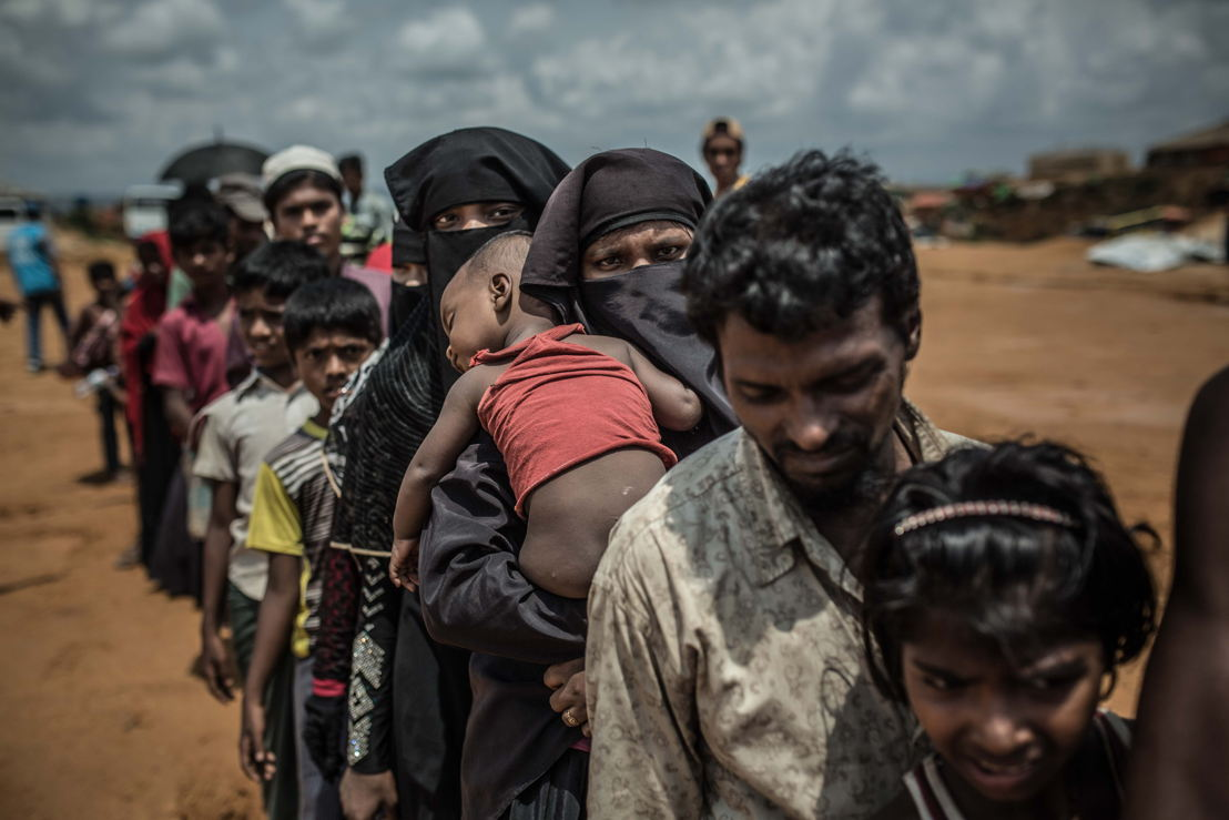 A group of Rohingya refugees wait in line for the assignment of their new homes in the Kutupalong camp, Cox's Bazar. Photographer: Pablo Tosco