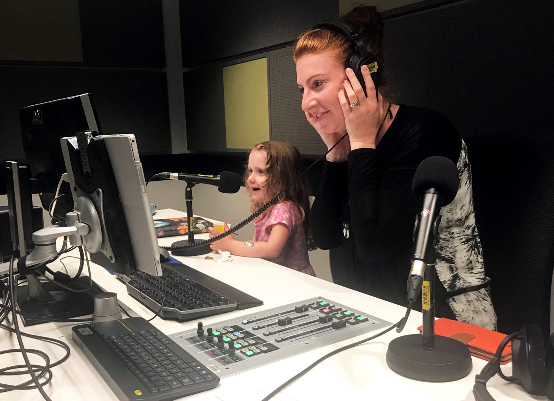 Host Brianna Peterson records Imagine This with little one Clara