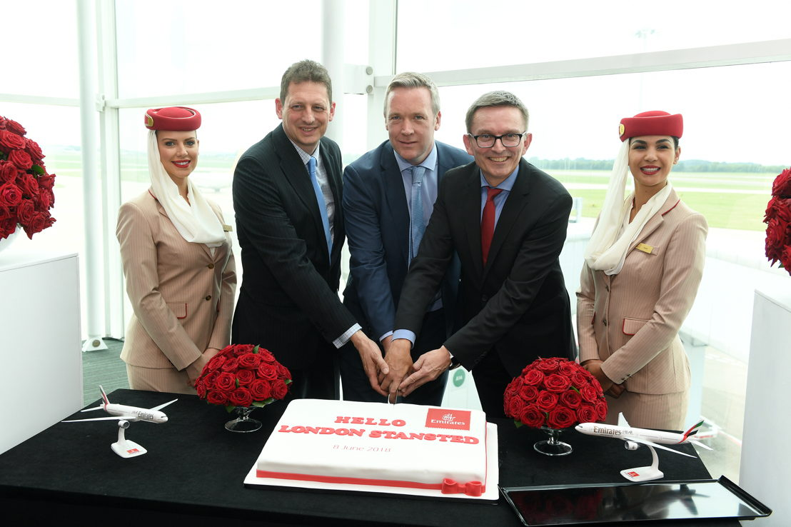 Flanked by Emirates cabin crew, (left to right) Richard Jewsbury, Emirates Divisional Vice President, UK, Ken O'Toole, Stansted Airport CEO, and Hubert Frach, Emirates Divisional Senior Vice President, Commercial Operations West, celebrate the new service with a cake cutting.