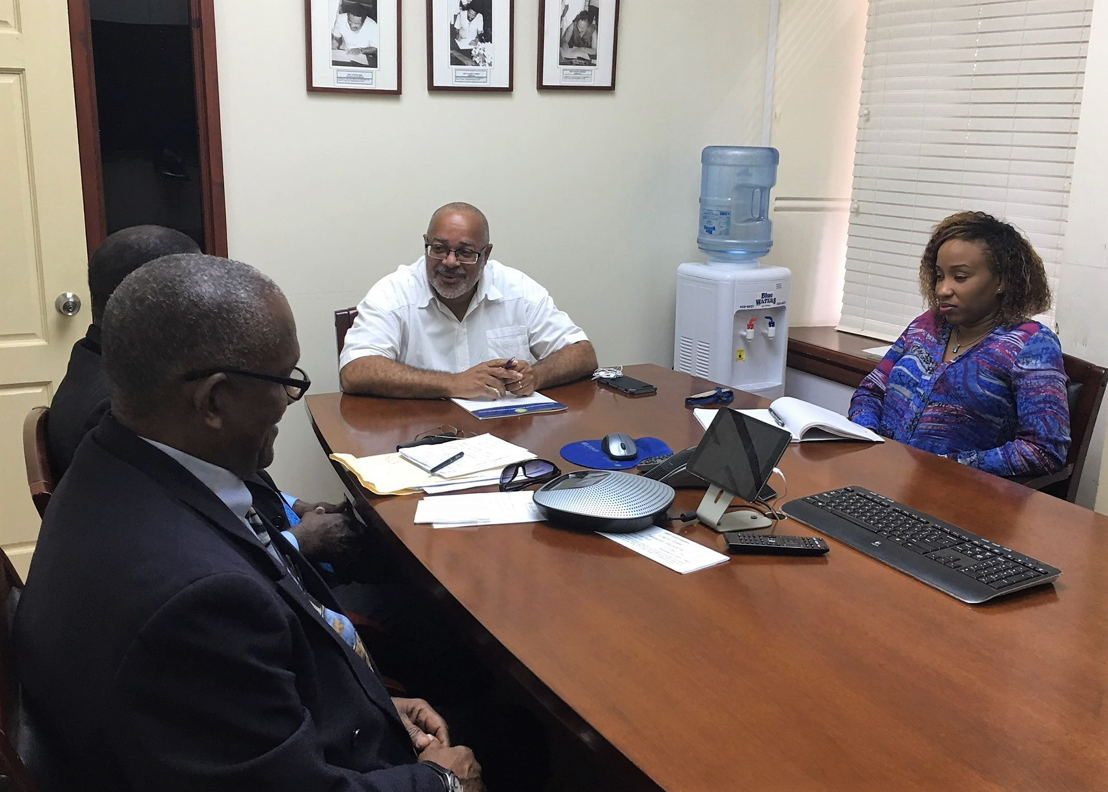 Mr. Alphonso Bridgewater, President of the ANOCES and Mr. Keith Joseph, Secretary General of the ANOCES, meet with Dr. Didacus Jules, OECS Director General, and Ms. Nadege Jn Baptiste, Programme Officer in the Development Cooperation and Resource Mobilisation Unit, at the OECS Headquarters in Castries, Saint Lucia.