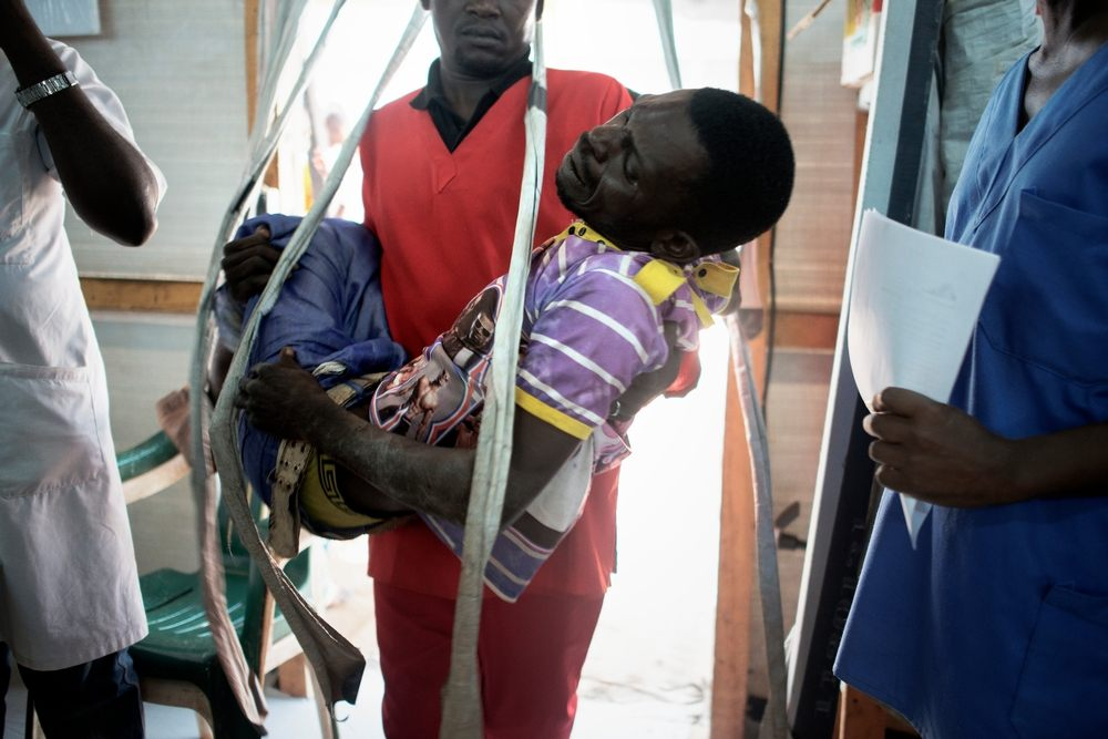 MSF159684<br/>A man is brought to the Medecins Sans Frontiers (MSF) hospital in a displaced persons camp in M&#039;Poko, Bangui.<br/><br/>After being tied up and beaten by a group of men after asking for payment, having polished their shoes. He was referred to the General Hospital in Bangui.