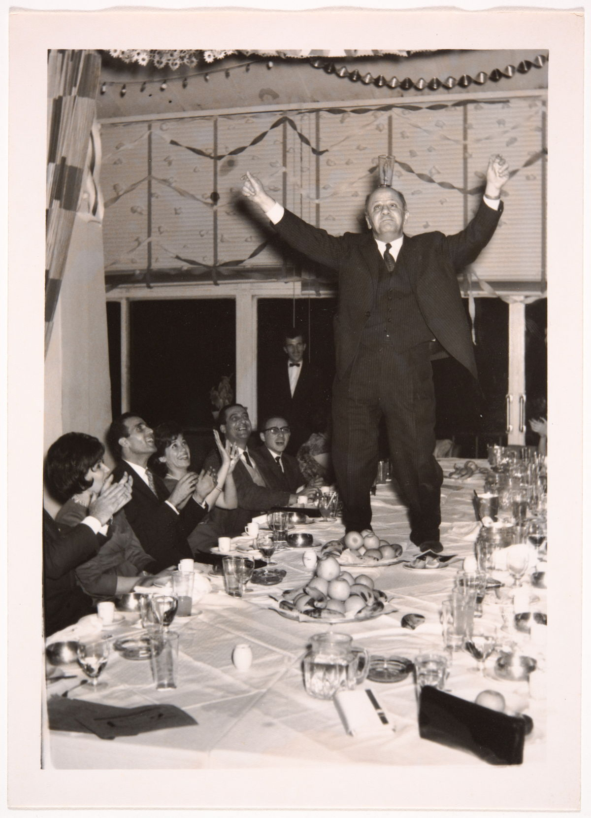 Snapshot at a dinner party. Taken by an unidentified photographer in Syria between 1950 and 1960. Gelatin silver developing-out paper print. 0159ko00005, 0159ko – Haifa Kocache collection, courtesy of the Arab Image Foundation, Beirut.