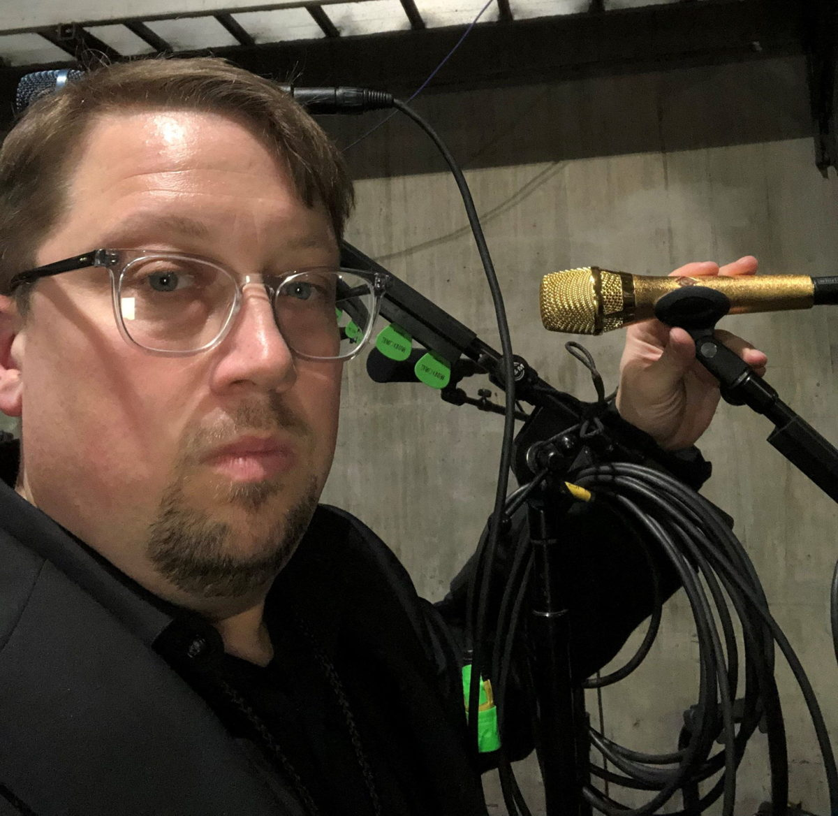 Sean Quackenbush, Front of House engineer for Brandi Carlile, pictured backstage at the 61st Annual Grammy Awards with the custom gold-colored Neumann KMS 105