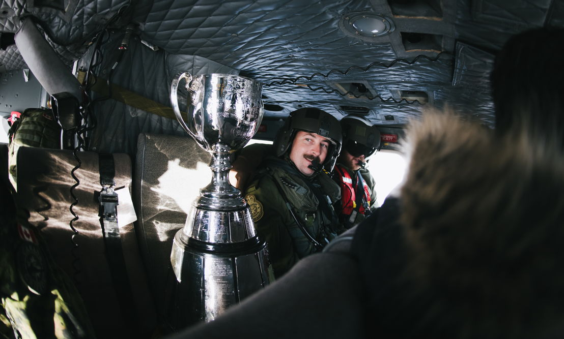 The Grey Cup travelling across Edmonton via military helicopter. Photo credit: Johany Jutras/CFL.ca