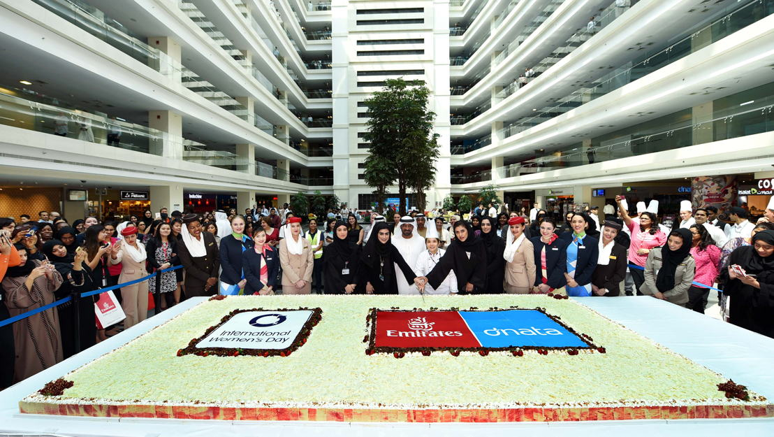 HH Sheikh Ahmed bin Saeed Al Maktoum, Chairman and Chief Executive, Emirates Airline and Group, cutting a cake with staff to celebrate International Women's Day at the Group's headquarters.