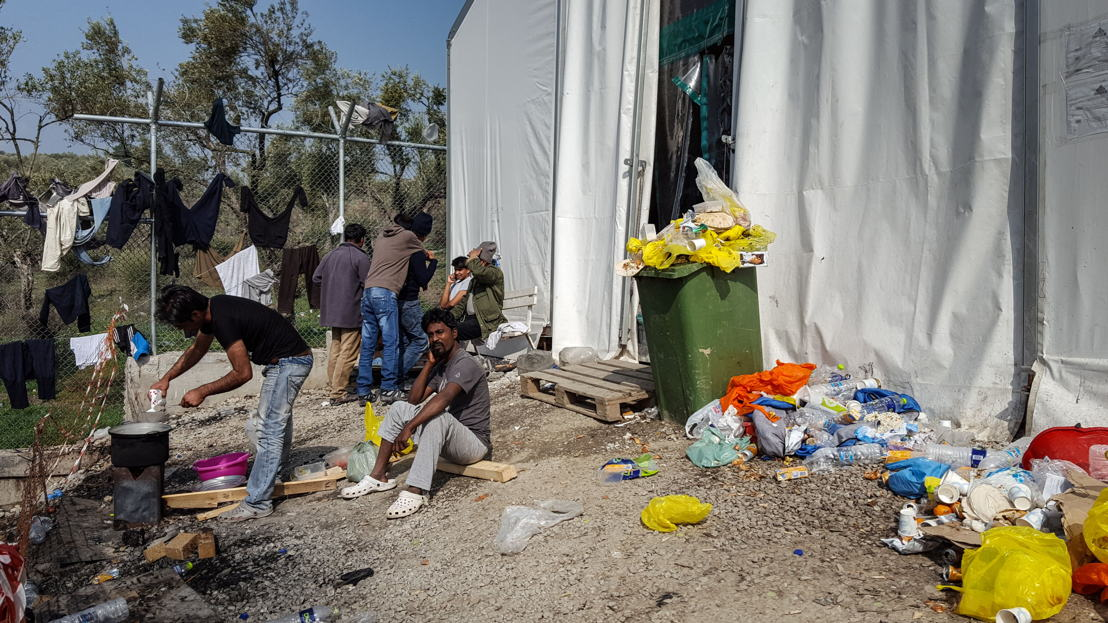 Refugees and migrants from Bangladesh and Pakistan inside Moria Camp.
