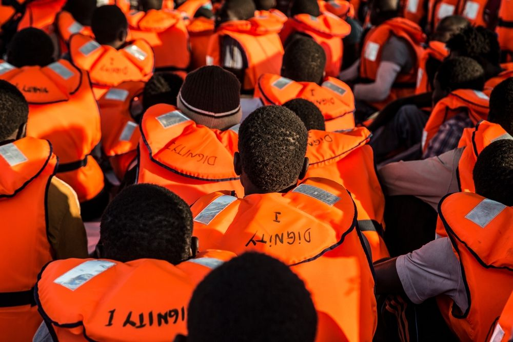 Photographer: Anna Surinyach<br/><br/>Caption: 87 people, mainly from Senegal and Gambia rescued by the Dignity I, wait on the deck to be transferred to an Italian vessel that will take them to Sicily.
