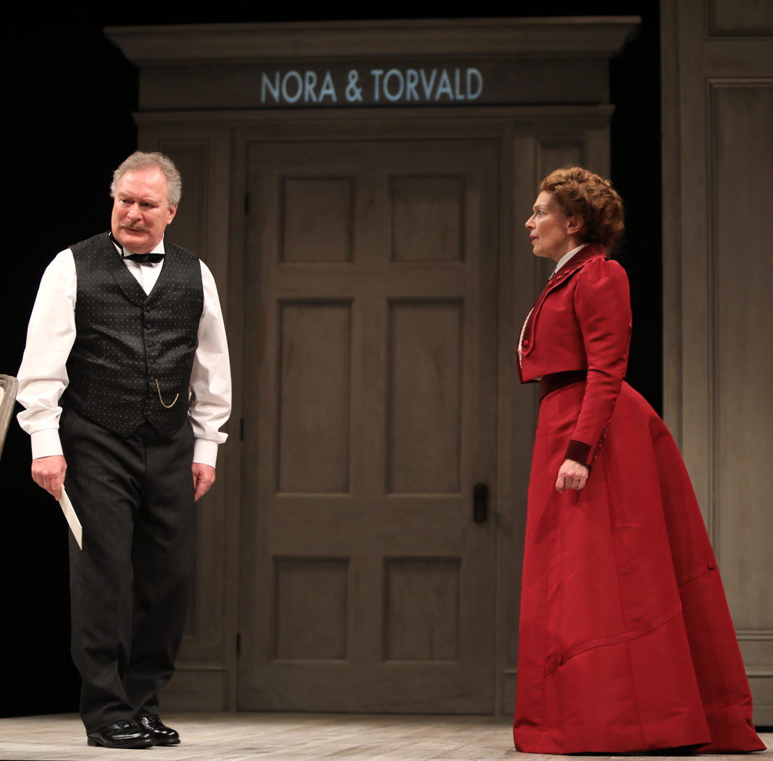 Benedict Campbell (Torvald) and Martha Burns (Nora)  in A Doll's House, Part 2 by Lucas Hnath / Photos by Tim Matheson<br/><br/>Canadian Premiere<br/>September 16 – October 14, 2018<br/>&lt;a href=&quot;https://www.belfry.bc.ca/a-dolls-house-part-2/&quot; rel=&quot;nofollow&quot;&gt;www.belfry.bc.ca/a-dolls-house-part-2/&lt;/a&gt;<br/><br/>Belfry Theatre, 1291 Gladstone Avenue, Victoria, British Columbia, Canada<br/><br/>Creative Team<br/>Lucas Hnath - Playwright<br/>Michael Shamata - Director<br/>Christina Poddubiuk - Set &amp; Costume Designer<br/>Kevin Fraser - Lighting Designer<br/>Tobin Stokes - Composer &amp; Sound Designer<br/>Jennifer Swan - Stage Manager<br/>Carissa Sams - Assistant Stage Manager<br/>Hilary Britton-Foster - Assistant Lighting Designer