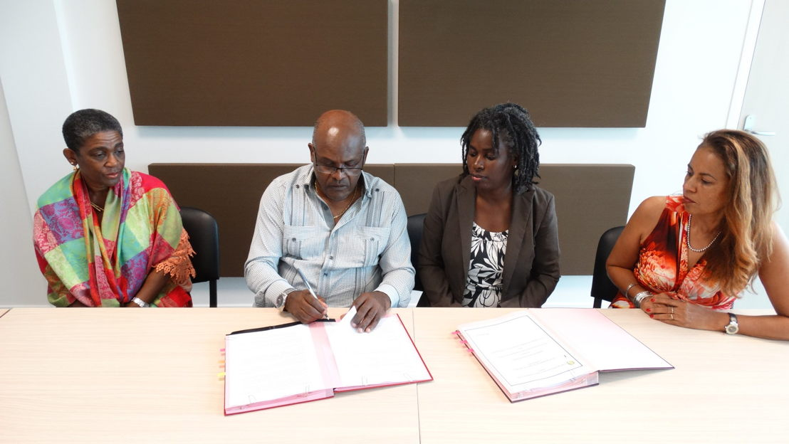 General Director of the CGSS, Mr. Henri Yacou, signs Protocole d'Accord (MOU) in Guadeloupe.