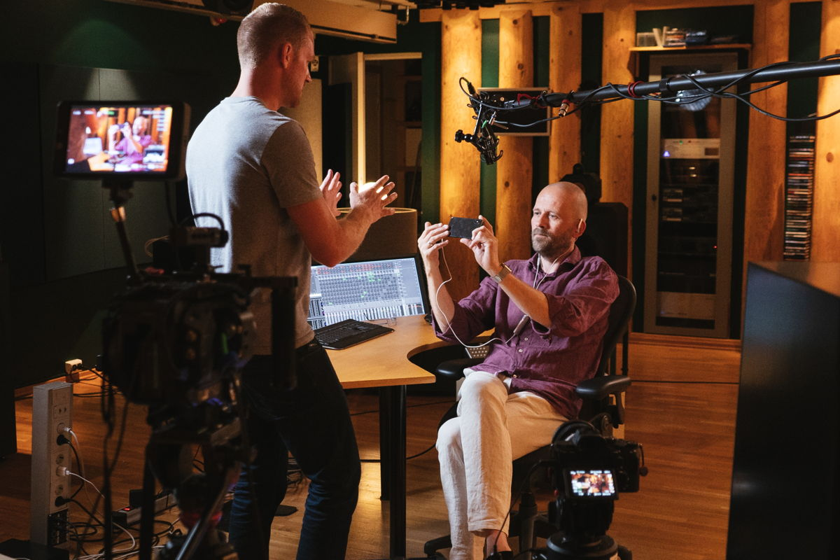 On set: James Capparelle (left) interviewing Morten Lindberg, Norwegian recording engineer and music producer, as he demoes Sennheiser's AMBEO Smart Headset