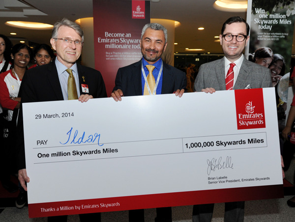 Ildar Gabdrashitov, winner of the Skywards Thanks-A-Million raffle is presented his Million Skywards Miles by Brian LaBelle, Emirates Skywards Senior Vice President (left) and Jonathan Bender, Secretary General Emirates Airline Foundation (right).